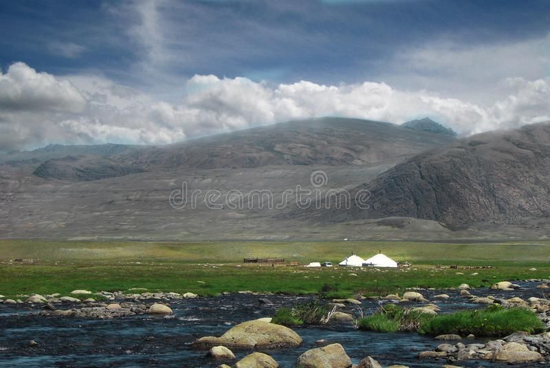 Mongolian yurt, called ger, in a landscape of north-west Mongolia. Blue river with stones stock photo