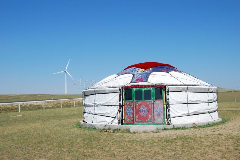 Mongolian yurt and windmill royalty free stock photo