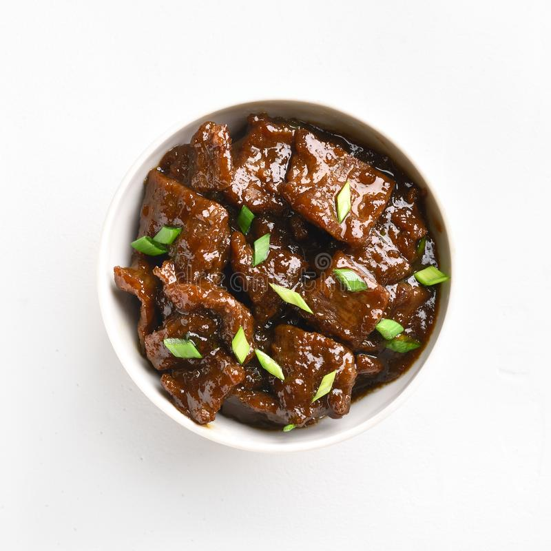 Mongools rundvlees in kom stock afbeeldingen
