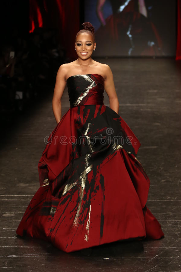 Monica Brown. NEW YORK-FEB 11: Singer Monica wears IEENA for Mac Duggal at Go Red for Women Red Dress Collection 2016 Presented by Macy's at New York Fashion stock image