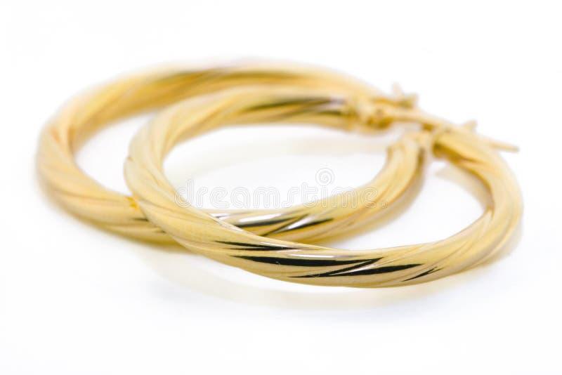 Monili dell'oro - orecchini fotografia stock