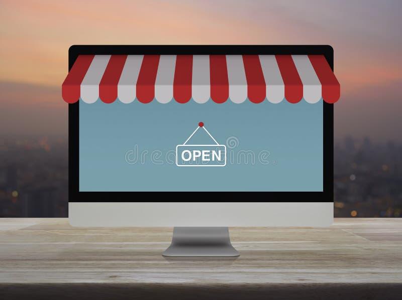 Monitor de computadora moderno de escritorio con el gráfico en línea de la tienda que hace compras y muestra abierta en la tabla  ilustración del vector