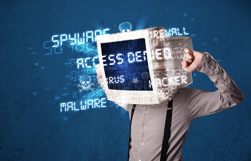 Monitor head person with hacker type of signs on the screen stock photography