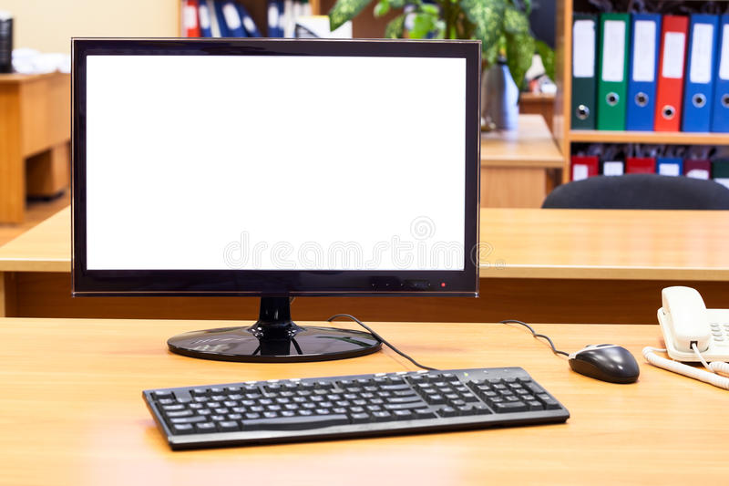 Monitor, keyboard, computer mouse on the office desk royalty free stock photography