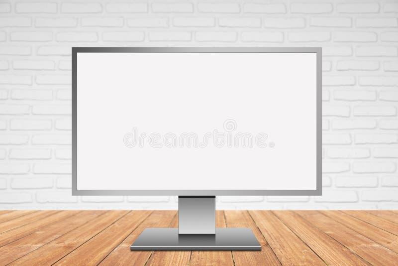 Monitor moderno do computador na tabela de madeira com a parede de tijolos branca fotografia de stock