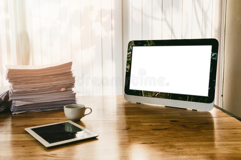 Monitor and office supplies on office desk. stock images