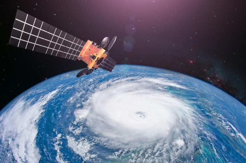 Monitoring hurricane. Satellite above the Earth makes measurements of the weather parameters and movement trajectory forecast. royalty free stock photo