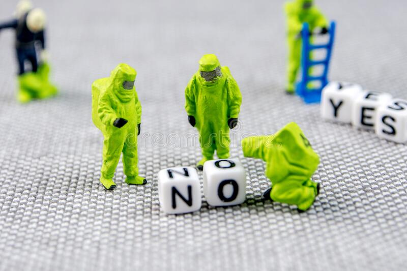 Monitoring and solving the problem with toxic word no, substituting it with yes life posture. Closeup of miniature figurines dressed like members of firemen royalty free stock photography
