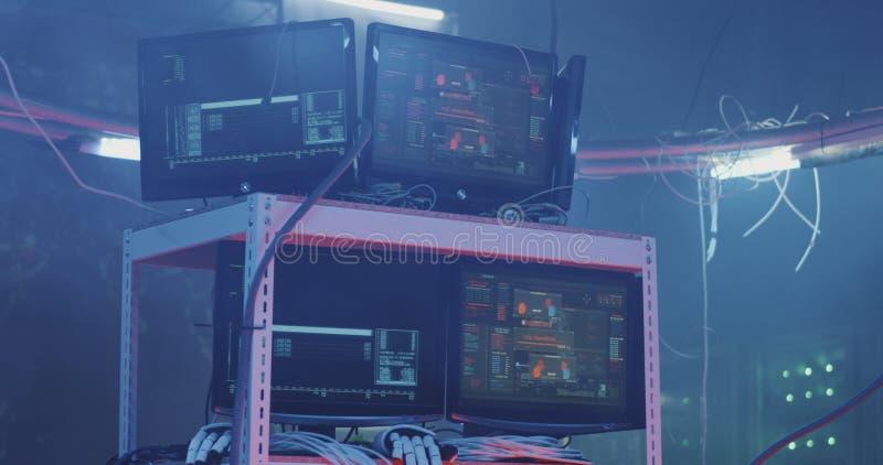 Monitors displaying various hacking activities. Full shot of multiple monitors displaying various hacking activities stock photography