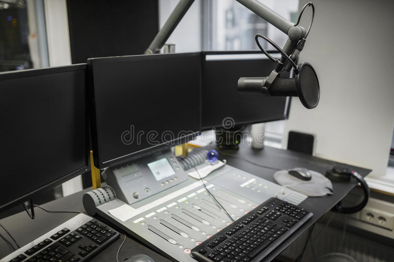 Monitors And Microphone Over Table In Radio Studio royalty free stock images
