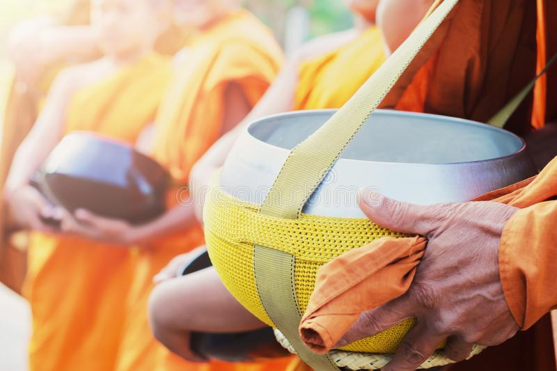 The monk alms round. In the morning stock photography