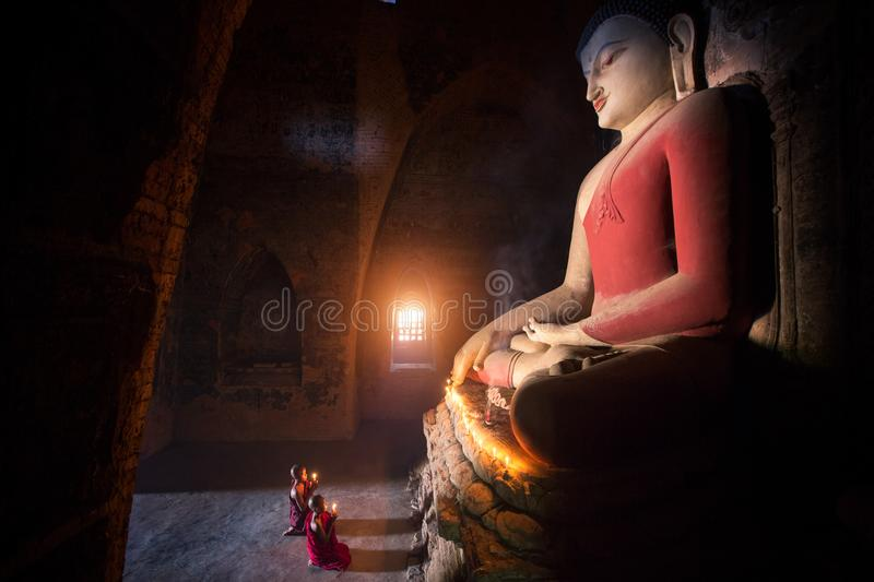 Monk in Bagan old town pray a buddha statue royalty free stock photography