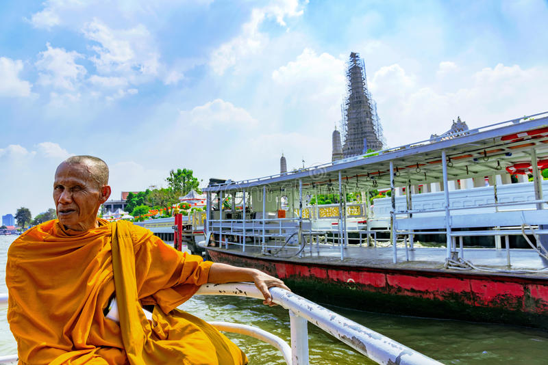 Monk on a boat on the Chao phraya river stock photo
