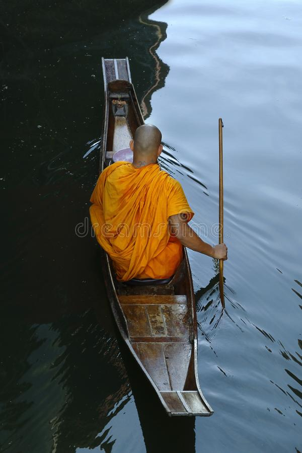 Monk on boat stock images
