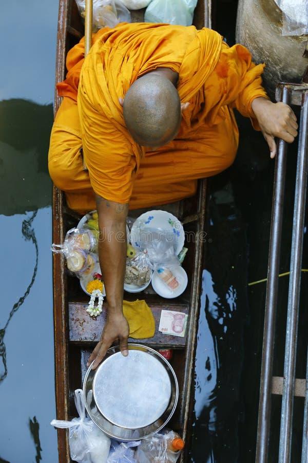 Monk on boat stock photos