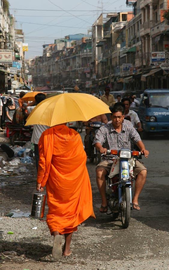 Monk collecting alms stock photos