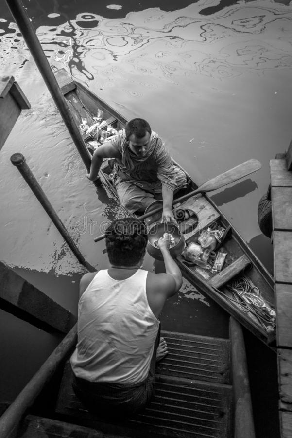 Monk Collecting Alms at Amphawa River stock image