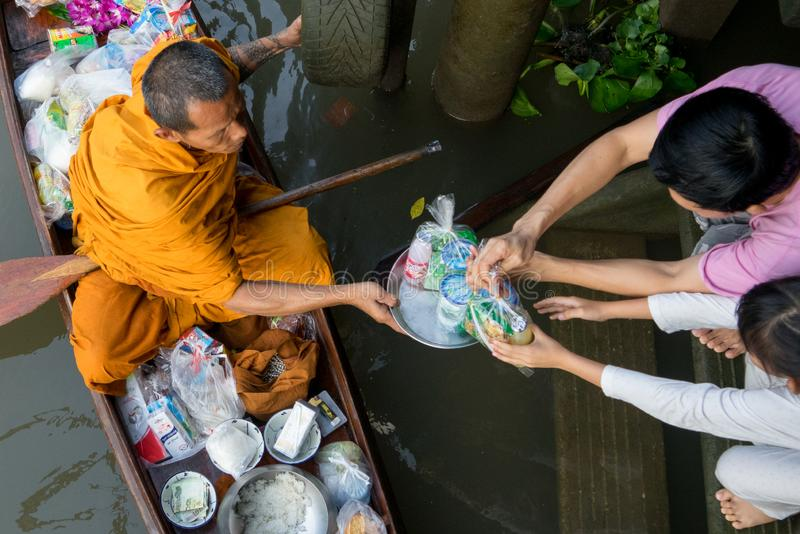Monk Collecting Alms at Amphawa River stock photography