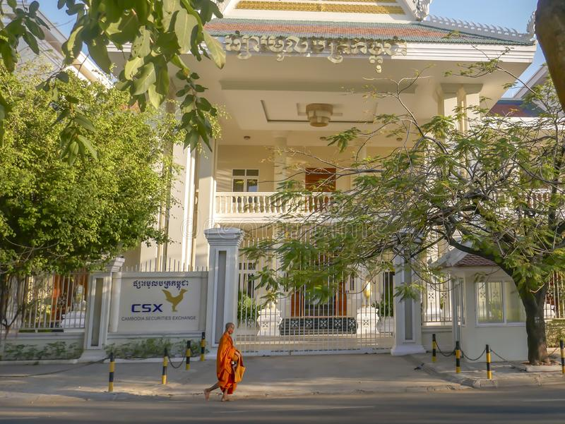 Monk collecting alms outside Cambodia Stock Exchange royalty free stock photography