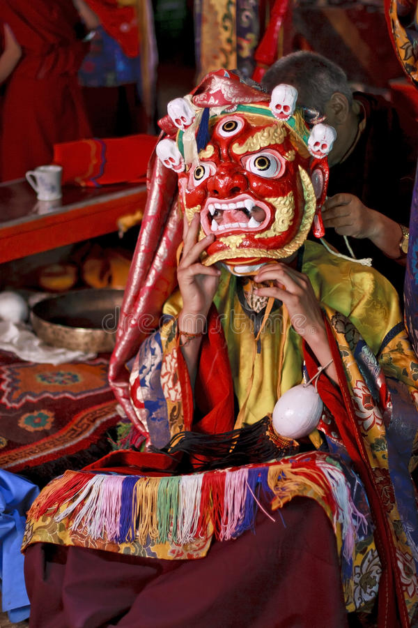 Monk dresses up for ritual dance at buddhist festi. Monk is dressing up to perform ritual dance at Buddhist festival in Thak-Thok monastery in Ladakh, India stock photos