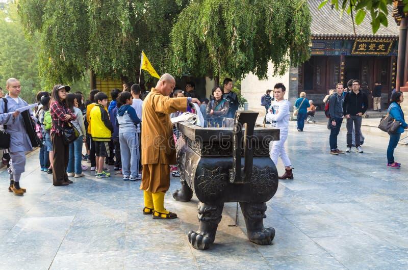 : Monk at Giant Wild Goose Pagoda, Xi`an, Shaanxi Province, China. stock photography