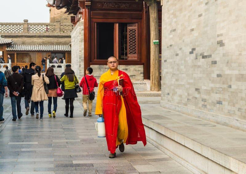 Monk at Giant Wild Goose Pagoda, Xi`an, Shaanxi Province, China. stock photo