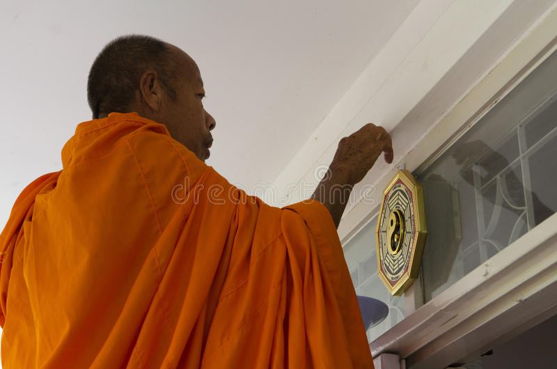 Monk giving blessing stock photography