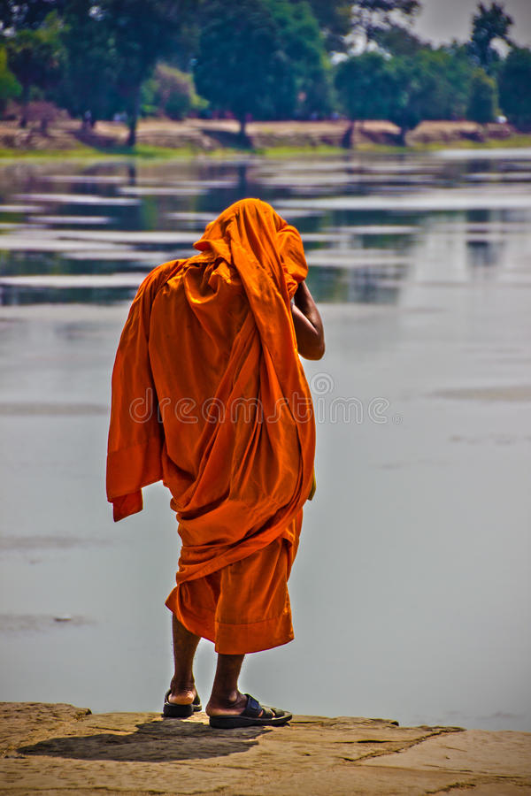 Monk. Looking into the water royalty free stock image