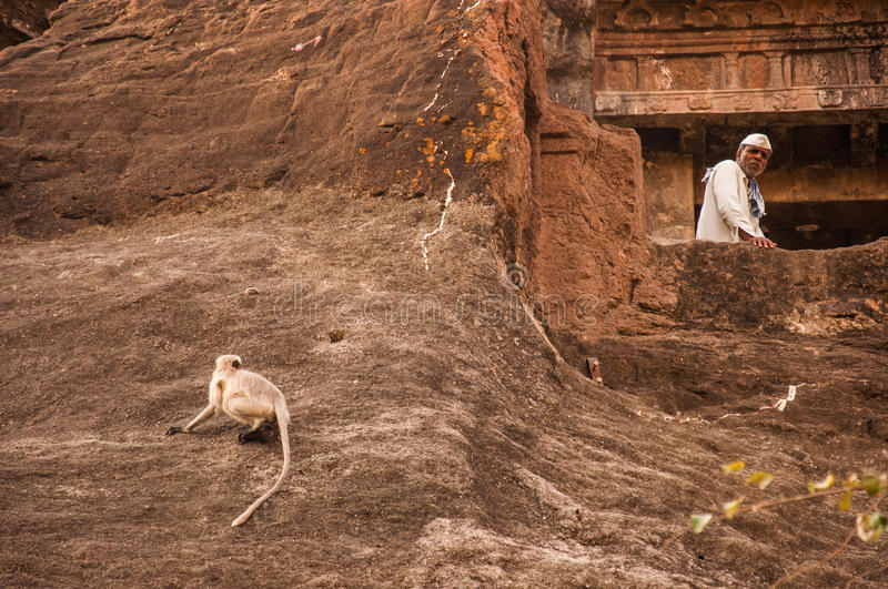 A monk and a monkey in Ajanta stock photography
