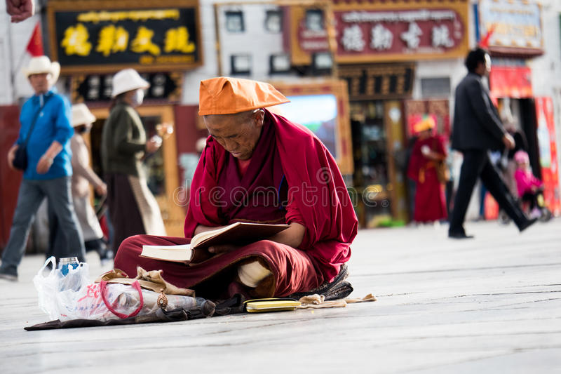 Monk near Jokhang Temple Lhasa Tibet. Jokhang Temple (House of the Lord) in Lhasa is the holiest site in Tibetan Buddhism, attracting crowds of prostrating royalty free stock photography