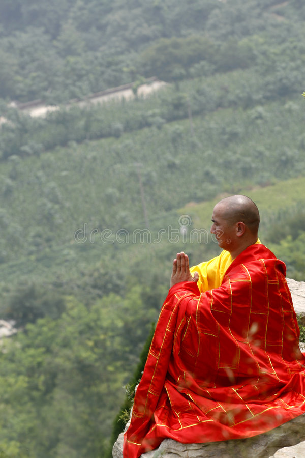 The monk in praying. In the mountain depths, the monk in praying royalty free stock photos