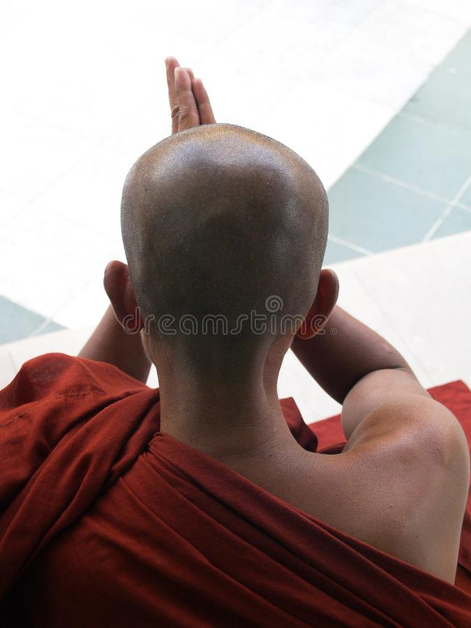 Monk with purple robe praying in temple. Yangon,Myanmar royalty free stock images