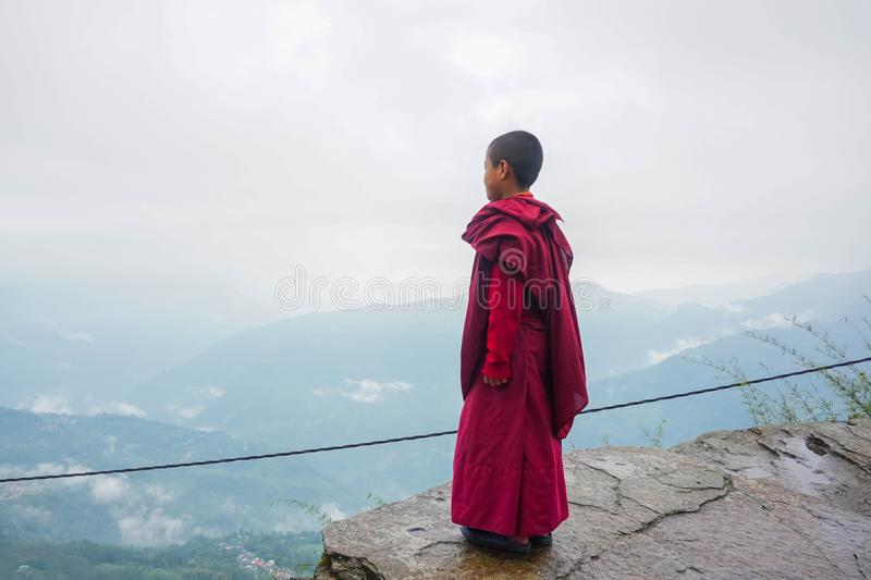 Monk on the rock. Sikkim, India. Monk on the rock. Buddhist monastery in Pelling city, Sikkim, India royalty free stock photography