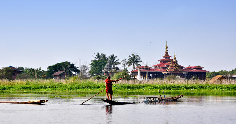 A monk rowing boat on the lake in Inlay, Myanmar royalty free stock photos
