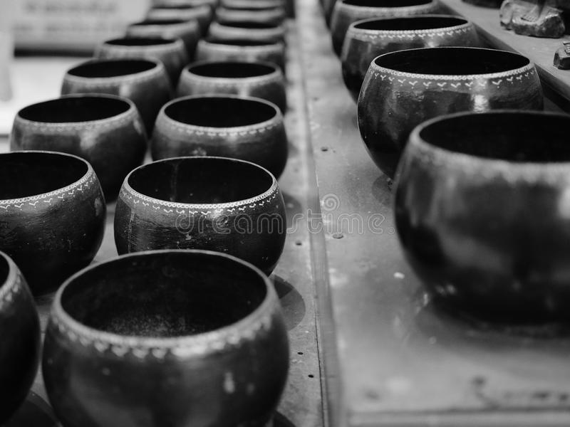 Monk's alms bowl. The monk's alms bowl process in black and white tone stock image