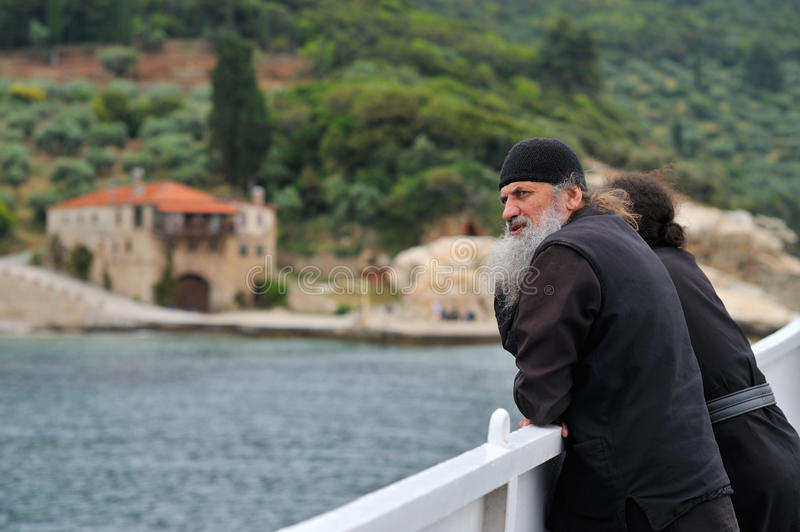 Monk s on a ferry while going to monastiry stock image
