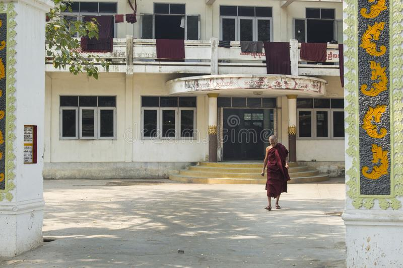 Burmese monk walking out his monastery Amarapura, Burma stock photo