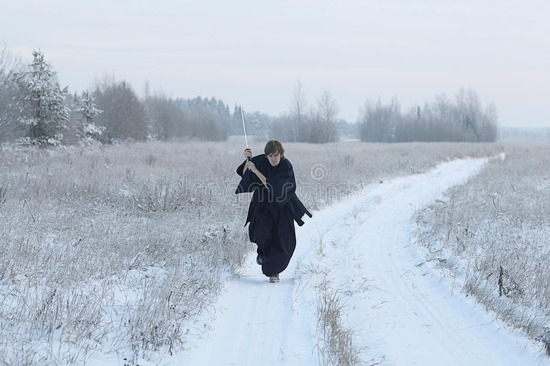 Monk samurai in winter field. Concept of the way Eastern philosophy royalty free stock photo