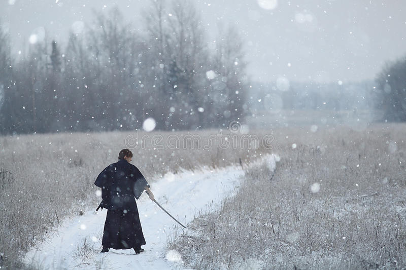 Monk samurai in winter field. Concept of the way Eastern philosophy stock image