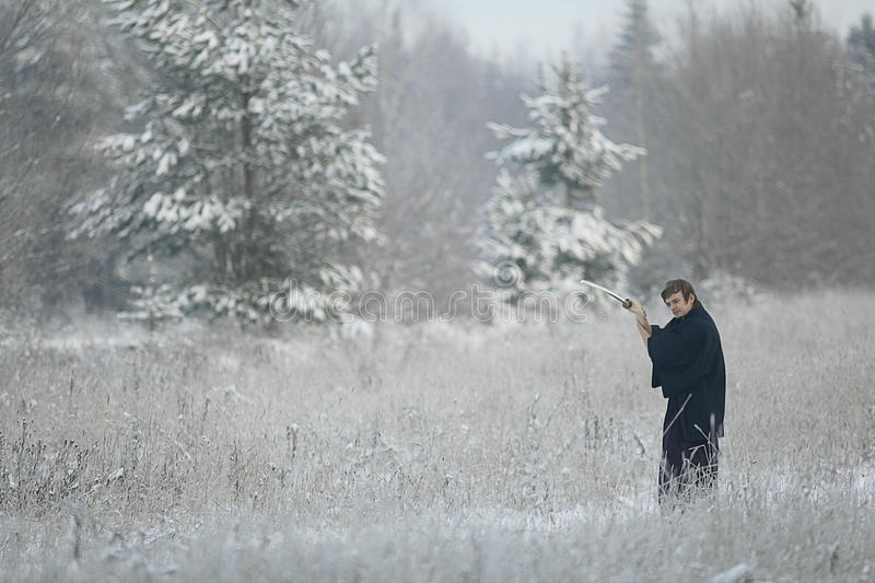 Monk samurai in winter field. Concept of the way Eastern philosophy royalty free stock photos