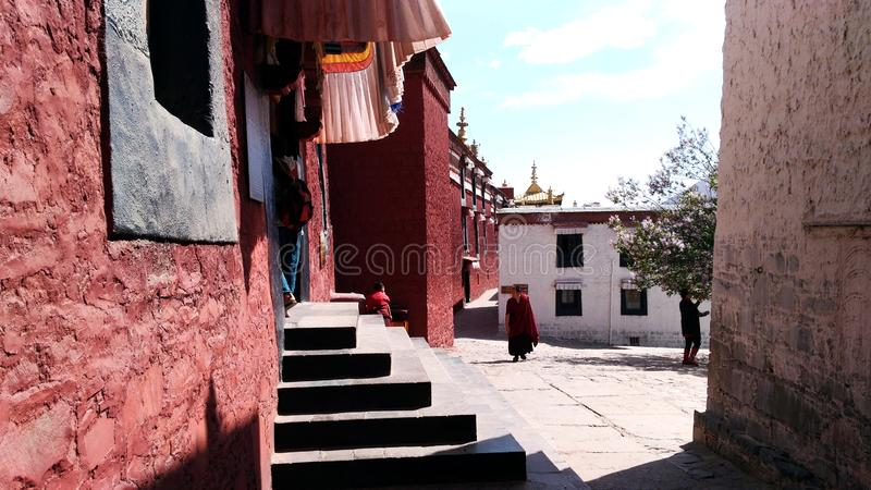 Monk in Shigatse. Asia travel, Tibet, Buddhism, a monk wanders around the Shigatse monastery royalty free stock image