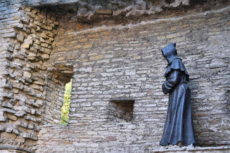 Monk statue in old town of Tallinn, Estonia royalty free stock images