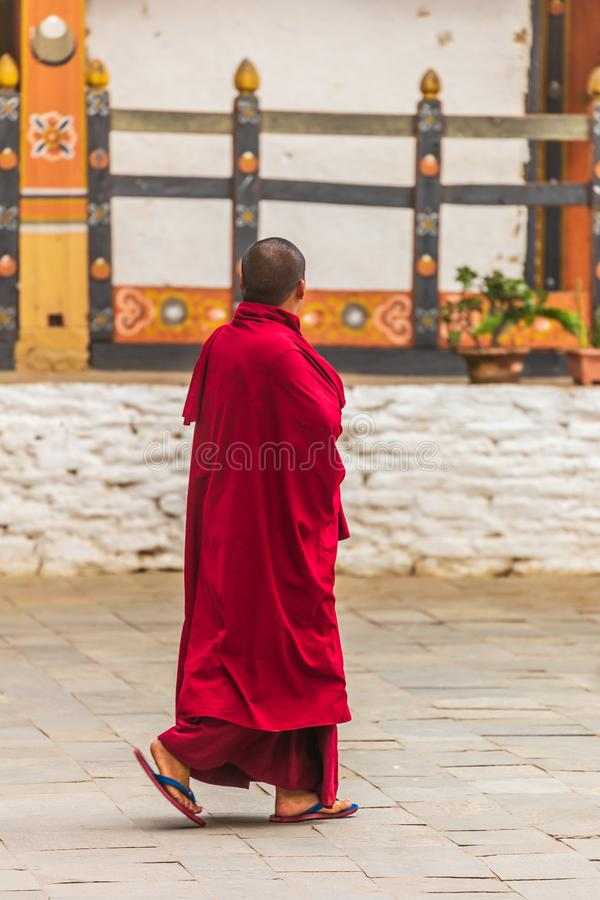 A walking Monk in Bhutan stock image