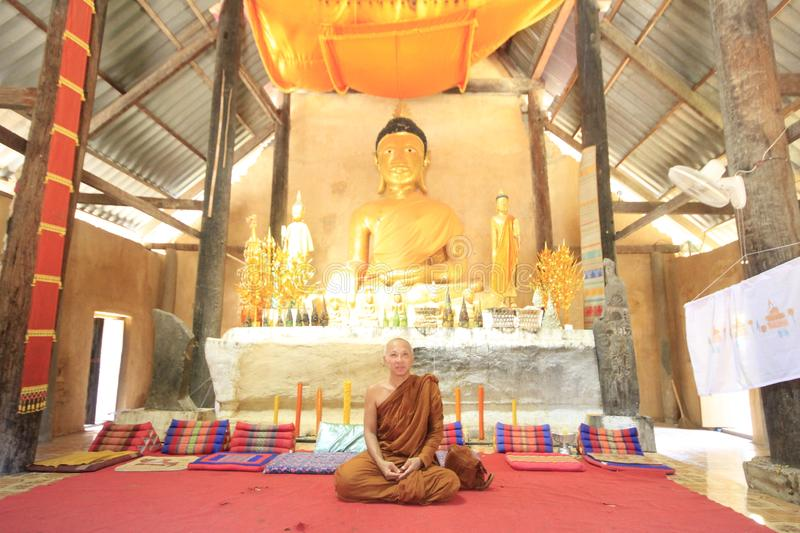 Monk in Temple Painting royalty free stock photography
