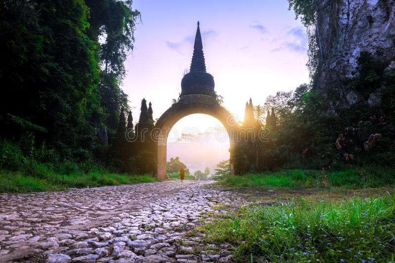 Monk walk to the front of the temple gate  at Khao Na Nai Luang Dharma Park in Surat Thani Thailand stock photography