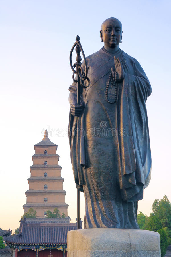 Monk Xuan Zang statue. The Monk Xuan Zang statue in front of Great Wild Goose Pagoda in Xi'an,Shaanxi,China. Xuan Zang was most famous monk of China ancient Tang stock photos