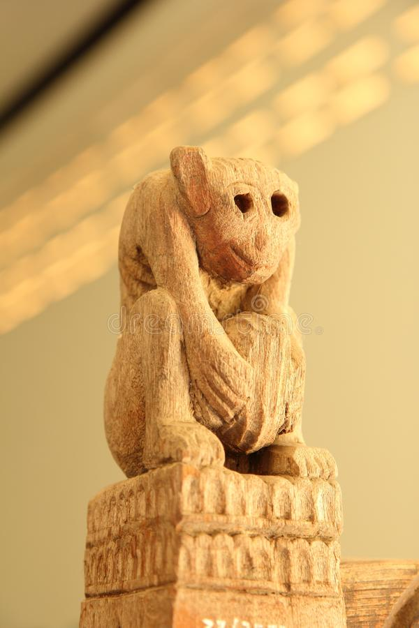 Monkey-carved wooden pillars royalty free stock photos