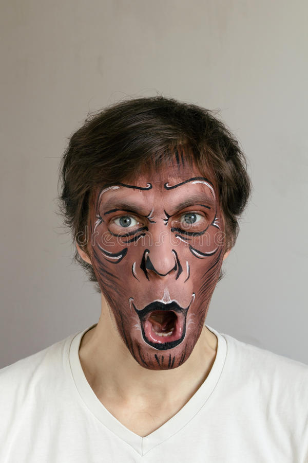 Monkey face painting stock photography