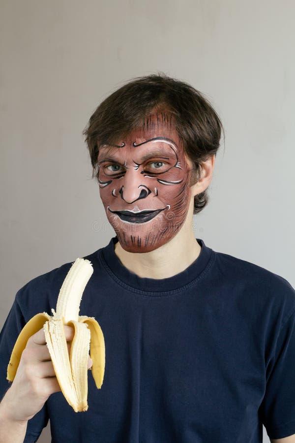 Monkey face painting stock photo
