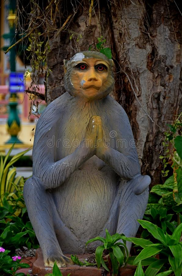 Monkey statue raising hands to pay respect at Wat Chantharangsee stock photo